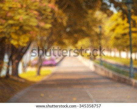 blur image of  the gold garden for background and side walk  - stock photo