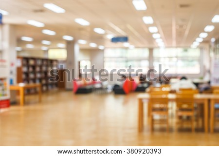 blur image of the library or Book shelf Knowledge and Research in Education. Library is a collection of sources of information and similar resources and sun light - stock photo