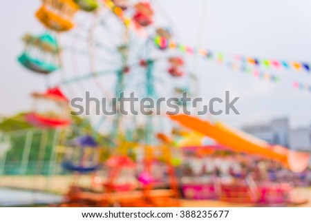 blur image of theme park on day time for background usage. - stock photo