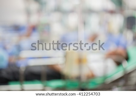 Blur image of urgently patients in emergency room at hospital - stock photo