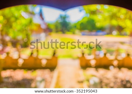 blur image of walkway with open space to the green garden for background usage . - stock photo