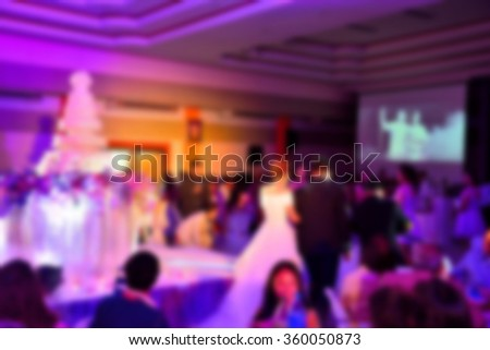 blur image of wedding party in large hall for background usage. - stock photo