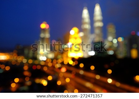 Blur image or bokeh light of Kuala Lumpur night scenery during blue hour.  Intentionally added blue tones to make the it look more atmospheric. - stock photo