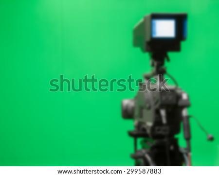 blur image TV camera in studio a green - stock photo