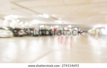 blur image with bokeh of Car park interior for background usage. - stock photo