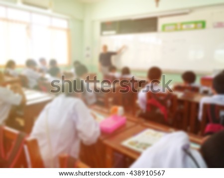 Blur kids and teacher in the classroom for background usage.vintage tone filter. - stock photo