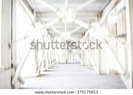 Blur modern background. Empty car park with roof truss and slabs floor. - stock photo