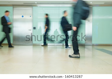 Blur Movement Business people walking in Rush Hour, London, UK - stock photo