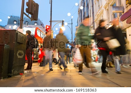 Blur movement of city people worker, shopping on Oxford Street, London, England, UK  - stock photo