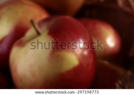 Blur natural fruitage background of fresh beautiful ripe juicy pouring red and yellow one apple closeup and fruit in back, horizontal picture - stock photo