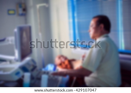 Blur of doctor sitting at the ultrasound device,Echocardiography - stock photo