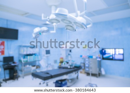 Blur of equipment and medical devices in modern operating room take with art lighting and blue filter,operating room with modern equipment.Operating room ready for operation - stock photo
