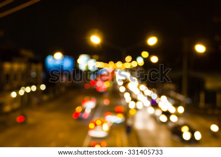 Blur of lights from cars at night on the road, a very beautiful bokeh. - stock photo