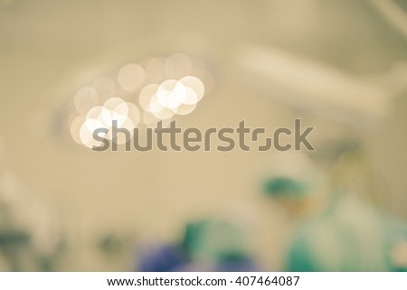 Blur of patients and teamwork in operating room during surgery - stock photo