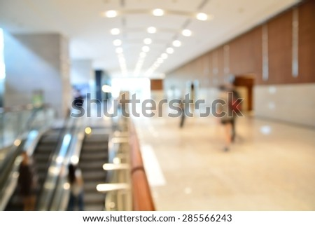 Blur or Defocus Background of Modern Building with Escalator. - stock photo