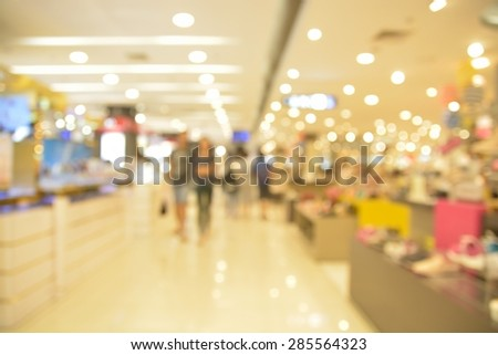 Blur or Defocus of People Shopping in Department store with Bokeh as Background. - stock photo