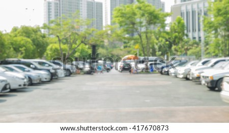 Blur outdoor car park in the official place and the hot sun. Cars parked in a row. blur and abstract background - stock photo