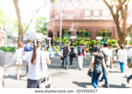 Blur people in rush hours at orchard road background with sunflare effect filter processing - stock photo