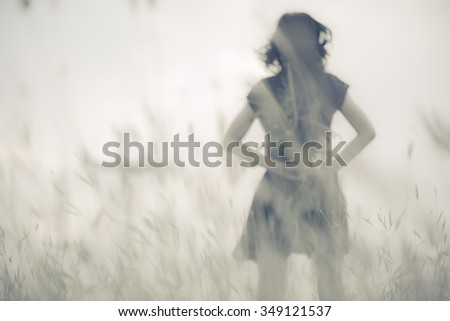 Blur photo of emotions moment of girl with flowers waiting for first summer. - stock photo
