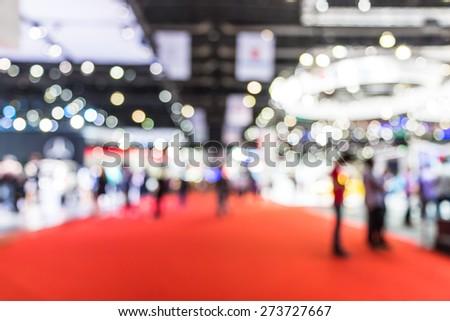 blur photo of motor show, car show room - stock photo