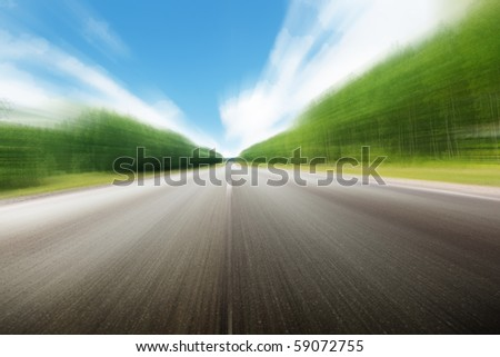blur road in Russian forest - stock photo