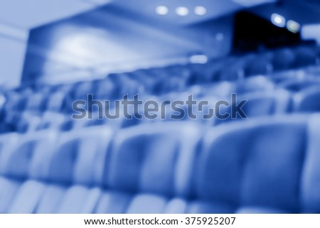 blur row of  empty blue auditorium or theater seat - stock photo