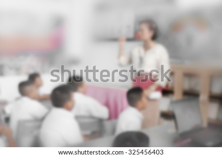 Blur schoolboys sitting in front of classroom listening for lecture and school project home work - stock photo