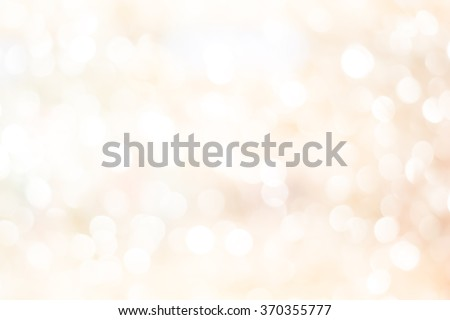 Blur shining brighten soft cream yellow wallpaper with circle lantern:abstract blurred background in light toned.blurry bulbs ball motion of golden colored backdrop.blurry sparkle glitter concept. - stock photo