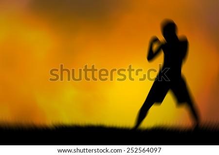 blur silhouette Thai boxing  Orange background - stock photo