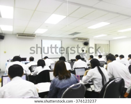 Blur student during study or lecture and quiz with teacher or professor in classroom with notebook in master degree of industrial management Engineering programs or MBA at Thailand university  - stock photo