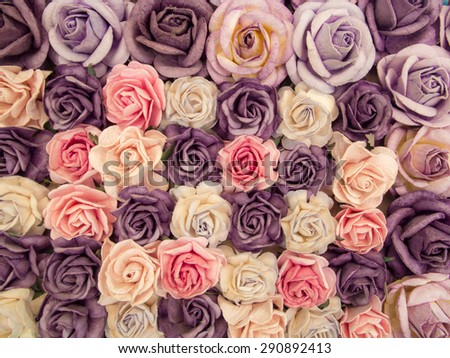 Blur style photo of the paper beautiful roses background for decorate the wedding ceremony. - stock photo