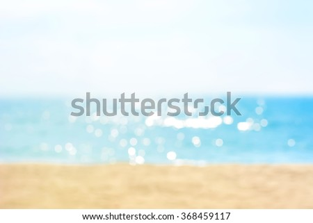 Blur summer white sand beach with sparkling sea water - stock photo