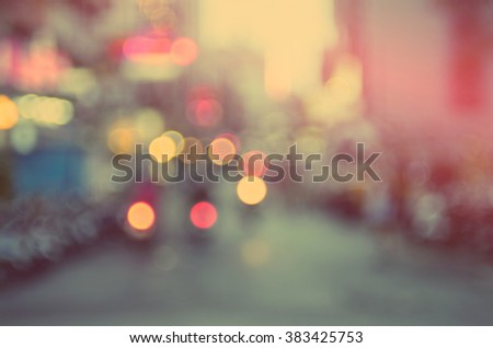 Blur traffic road with colorful bokeh light abstract background.Retro color style. - stock photo