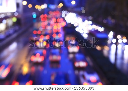 Blur trffic and car lights bokeh in rush hour background. - stock photo