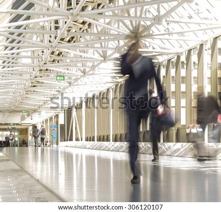 blur woman walking on walkway - stock photo