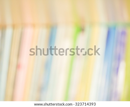 Blured books in public library. - stock photo