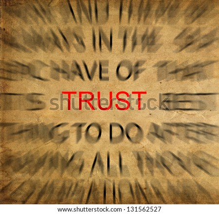 Blured text on vintage paper with focus on TRUST - stock photo