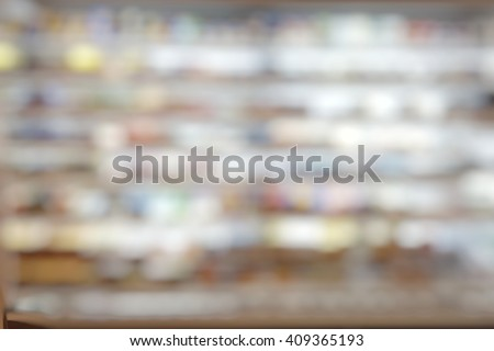 Blurred abstract background of dairy and frozen food  on shelves in supermarket. - stock photo