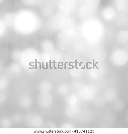Blurred abstract background of reflective shiny silver magical bokeh of crystal mobile chandelier lamp bright white color lighting in vintage colour tone: Sparkling lights of crystal glass reflection - stock photo