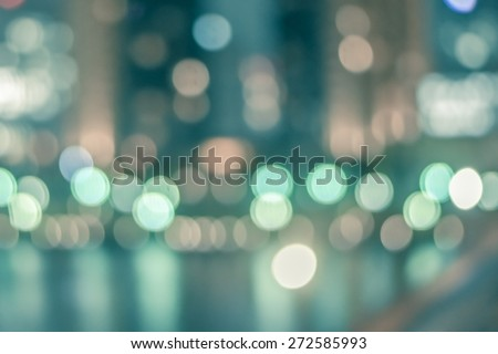 Blurred abstract background of Tokyo night lights on riverfront with water reflections and colourful bokeh in vintage style - stock photo