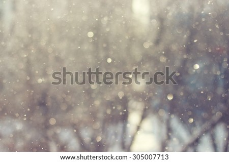 Blurred abstract background. Sunlight winter snowflake background. Magic light background.  - stock photo
