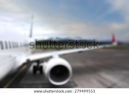 Blurred background : airplane wing at airport.  vintage business travel concept - stock photo