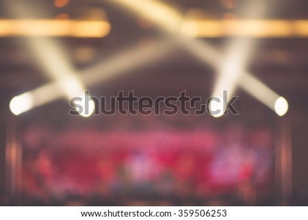 Blurred background : Bokeh lighting in concert with audience, Music showbiz concept, vintage filtered image. - stock photo