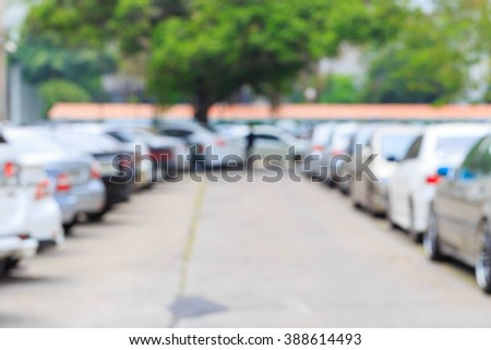 Blurred background car in outdoor parking lot  - stock photo