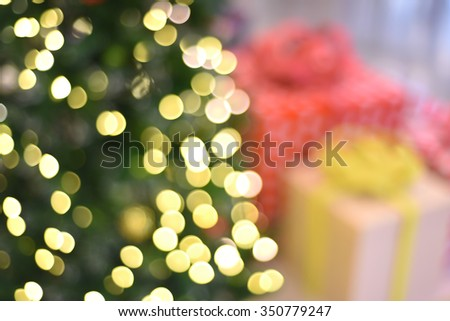 blurred background - Christmas presents and Christmas tree with bokeh - stock photo