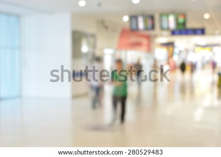 Blurred background : Clean the floor at airport terminal blur background with bokeh light - stock photo