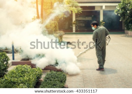 Blurred background fogging to eliminate mosquito for prevent spread dengue fever - stock photo