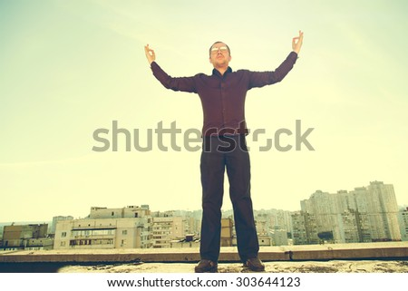 Blurred background image for a man in open space. Man on the background of the city and sunset. Lifestyle, enjoy life, enjoyment, freedom, happy man, enjoying nature. Man over blue sky and sunset. - stock photo