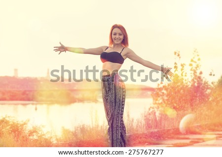 Blurred Background image for a woman in open space. Girls on the background of the city and sunset. Lifestyle, enjoy life, enjoyment, freedom happy woman enjoying nature. Beauty girl over sky and sun. - stock photo