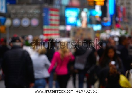 Blurred background image of tourists and business people walking through midtown Manhattan New York City on a spring evening during the afternoon rush hour. - stock photo